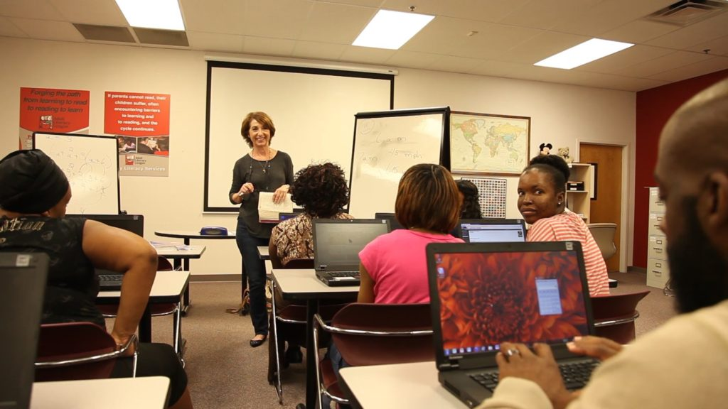 Francesca Mathews, one of the Adult Literacy League's long-time tutors, teaches adult students in the new GED lab.